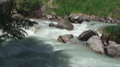 The wood in mountains and the prompt mountain river runs on stones Stock Footage