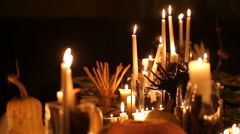 Halloween holiday table with candles Stock Footage