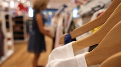 Female Buyer Shopping in Clothing Store at Shopping Mall Stock Footage
