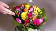 Hand on bunch of flowers. - stock footage