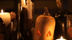 Candle and pumpkins on a table - stock footage