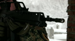 German soldier from bundeswehr with gun look at object to attack. Close up view. Stock Footage