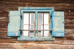 Old weathered widow - stock photo