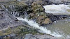 Mountain stream between stones. Little rapids. - stock footage