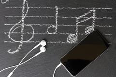 Music notes with  headphones Stock Photos