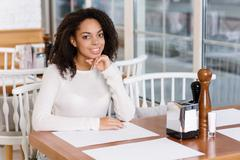 Young lady sitting at the restaurant Stock Photos