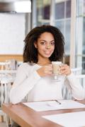 Restaurant guest is drinking coffee - stock photo