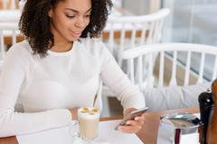 Young woman is using her smartphone Stock Photos