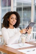 Restaurant customer posing with portable tablet Stock Photos