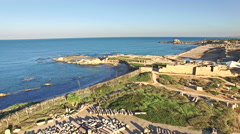 Aerial Israel. Panning view over Caesarea Maritima ancient roman amphitheater Stock Footage