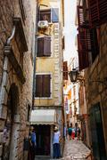 Kotor, Montenegro - August 10, 2015 : View of a narrow street with numerous s - stock photo