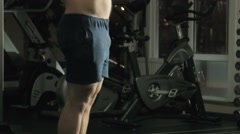 The man the weightlifter lifts a bar in a gym Stock Footage