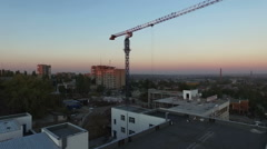 Tower crane at sunset. Departure quadrocopters. Aerial photography - stock footage