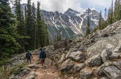 Two people hiking, Banff National Park, Alberta, Canada - stock photo