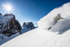 Man skiing off piste, Dolomites, Italy - stock photo