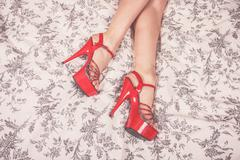 Woman wearing red heels in bed Stock Photos