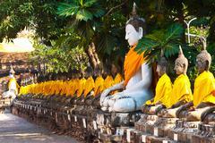 Buddha statues at the temple of Wat Yai Chai Mongkol in Ayutthaya Stock Photos