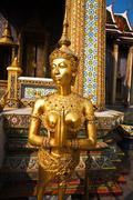 A kinaree, a mythology figure, in the Grand Palace in Bangkok Stock Photos