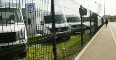 Volkswagen Commercial Vehicles trucks behind fence Arkistovideo