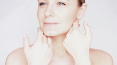 Beautiful woman touching her face at spa. Full HD Video Stock Footage