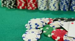 Stock Video Footage of Poker chips and two aces on a green poker table, dolly