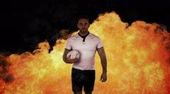 Tough rugby player holding ball Stock Footage