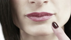 Close up view of a woman touching her lips - stock footage