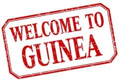 Guinea - welcome red vintage isolated label - stock illustration