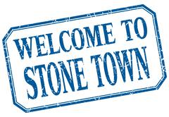 Stock Illustration of Stone Town - welcome blue vintage isolated label