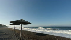 Wild lava beach on santorini island in greece Stock Footage