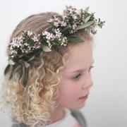 Girl wearing flower headdress - stock photo