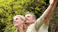 Couple with outstretched arms Stock Footage