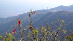 Believers tie the pray red stripe in the peak of xiangshan mountain,beijing Stock Footage