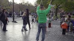 Bubble popping with children in Washington Square Park in slow motion in NYC Stock Footage