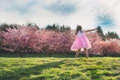 Rear view of a young girl spinning - stock photo
