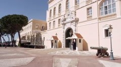 Monaco Montecarlo Palais Princiér Royal Palace entrance with cannons and guard Stock Footage