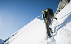 Man mountain climbing at Bianco Ridge, Swiss Alps, Bernina region, Switzerland Stock Photos