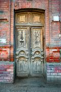 Detail of the facade with vintage wooden door in Astrakhan, Russia Stock Photos