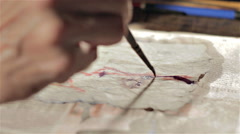 Drawing with watercolors on wet paper - stock footage