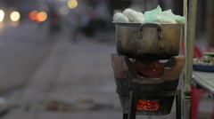 Boiled eggs boiling on roadside with traffic in evening,Poipet,Cambodia Stock Footage