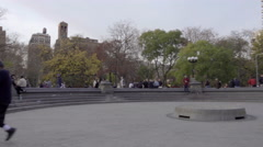 panning across center circle of Washington Square Park, musicians, girl dancing - stock footage