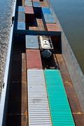 ship on river transports container - stock photo