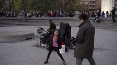 Girl top-rocking, dancing for man in center Washington Square Park slow motion Stock Footage