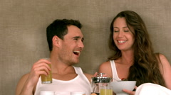 Pretty smiling couple eating breakfast Stock Footage