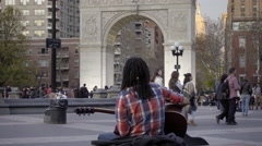 Black musician playing guitar in Washington Square Park in 4K, NYC Stock Footage