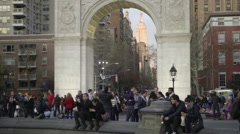 Panning shot Empire State Building arch Washington Square Park slow motion, NYC Stock Footage