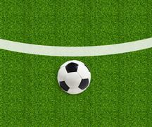 Stock Photo of Soccer ball on green field grass