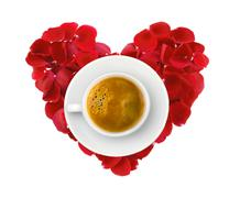 Beautiful heart of red rose petals and cup of coffee isolated on white Stock Photos