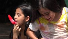 Young Girls Eating Popsicles Stock Footage