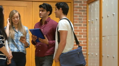 Smiling students discussing in hallway Stock Footage
